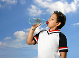 Thirsty boy drinking fresh water outdoors wearing sport clothes poster