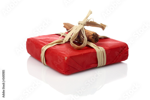 A red gift reflected on white background