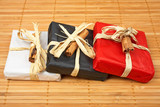 Three gifts with shadow on bamboo mat. Shallow DOF