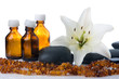 madonna lily spa stones bottles and amber on white