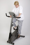 woman shocked at results on excercise bike poster
