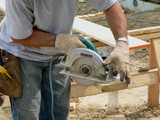 Carpenter with circular saw poster