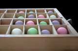 pastel gumballs in a type case