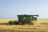 combine on wheat field poster