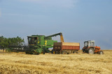 combine and tractor on harvest wheat field poster