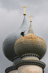 The spiderman on a dome of church