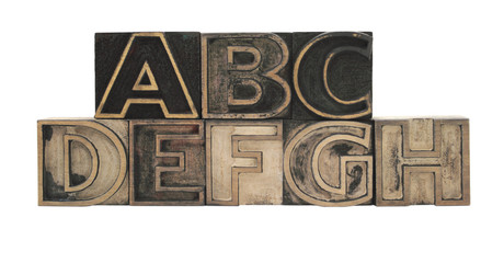 old, inkstained letterpress wood outline type letters A-H