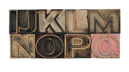 old, inkstained letterpress wood outline type letters I-Q