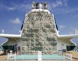 Climbing wall by smokestack on a cruise ship. poster