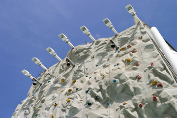 A climbing wall from below.