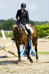 girl on a horse show jumping competition