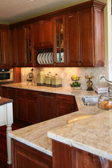 Modern kitchen with cherry cabinets and granite counter tops