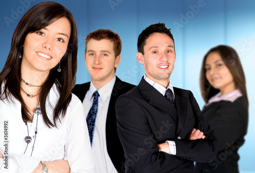 businesswoman leading business team in an office environment