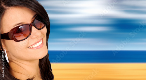 beach fashion portrait of a girl wearing sunglasses