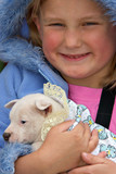a young girl is holding a very small fox terrier pup poster