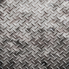 a very large sheet of rough black diamond plate