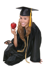 A beautiful woman graduate with an apple over white