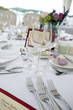 Wedding table arrangement with flowers and seating list