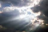 Sunbeams shining through storm clouds. poster