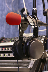 Microphone with head phones in broadcasting station