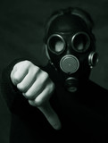 Hand of man in gas mask showing the hand down symbol