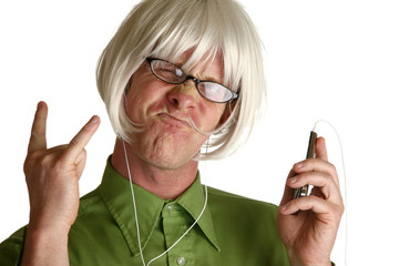 Blond wig on funny man with digital music player.