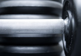 Dumbbells isolated on grey background poster
