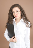 Young businesswoman portrait isolated on beige background poster