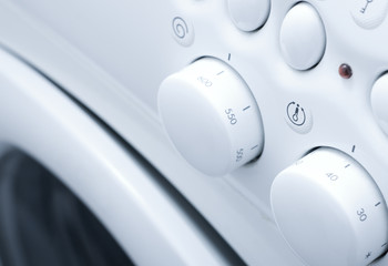 White washing machine with button close up