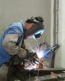 Welder working, welding steel tubes poster