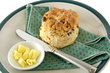 Fresh baked date scone with butter curls. poster