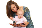 mother and 8 months baby girl reading book together  poster