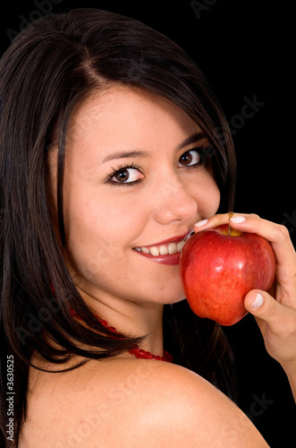 girl eating an apple over a white background