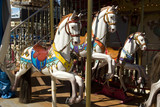 Carousel with white horse panoramic from the front poster