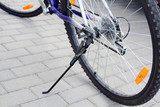 Bicycle, standing, focus on the rear wheel poster
