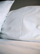 Starched White Pillows on Cozy Bed