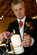 A groom lighting a candle in chapel