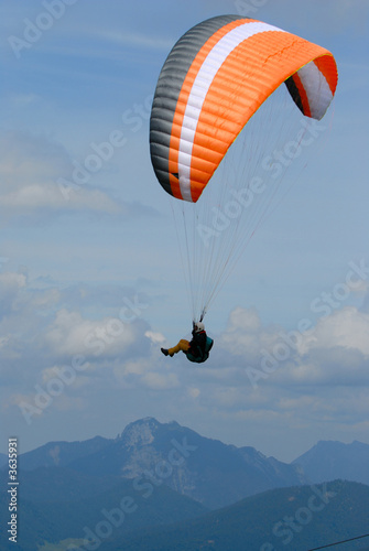 Fototapeta Paraglider in clouds the Alps sky over Bavaria