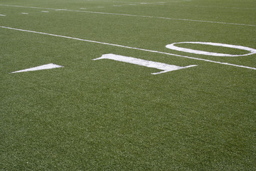 10 yard line on a green American football field.