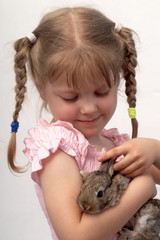 The girl is played with the rabbit