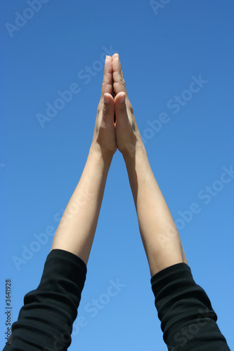 hands in a blue sky
