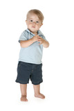 Boy of fifteen months standing barefoot over white background. poster