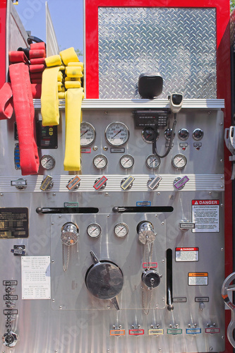 The ladder controls and hoses on a firetruck.