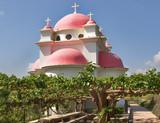 Orthodox church on coast of the lake of Tiberias poster