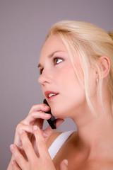 Beautiful blond woman talking on the phone