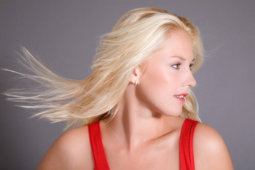Beautiful blond woman with wind in her hair