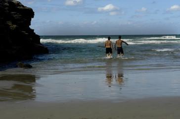 Two men having fun at the beach