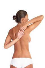 Beautiful woman stretching - high key shot in studio