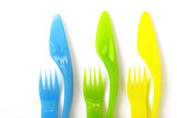 Colorfull plastic forks and knifes.