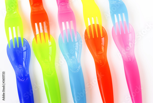 Colorfull plastic spoons, forks and knifes.